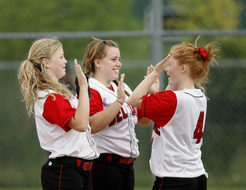 Thumb_softball-girls-team-mates-happy-163465